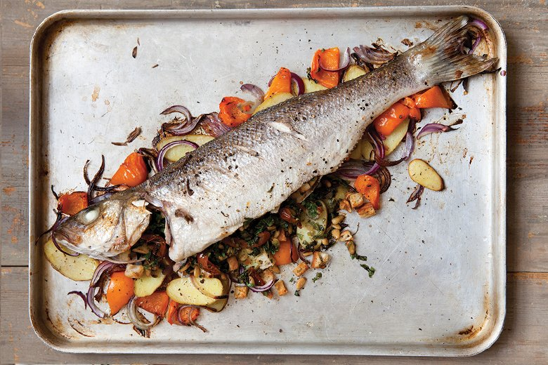 Whole baked fish with sun-dried tomatoes